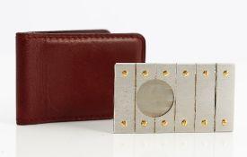 A Must de Cartier steel and gold sliding cigar cutter, of rectangular form,