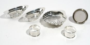Silver, comprising; a buttershell, Sheffield 1913, two napkin rings,