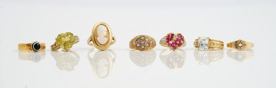 A collection of seven gold and gem set rings including a 22ct gold and banded agate set ring, 2.