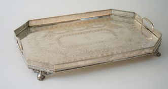 A Victorian silver plated twin handled gallery tray with engraved decoration,