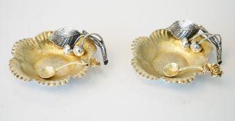 A pair of Italian silver salts, each of cast flowerhead form, lightly gilt,