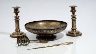 A silver circular bowl, with a decorated rim, raised on a plain circular foot, diameter 29cm,