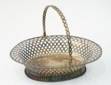 A late George II silver cake basket of oval form,