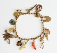 A gold charm bracelet, on an 18ct gold heart shaped padlock clasp,