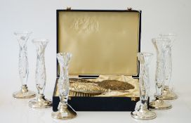 A lady's silver mounted hairbrush and mirror set, with embossed decoration,