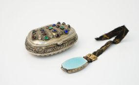 A European shaped oval hinge lidded snuff box, with scroll and partly fluted decoration,