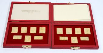Two sets of seven silver gilt replica stamp ingots,