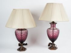 A pair of facet cut amethyst glass table lamps, with bronzed mounts and pleated shades (2).