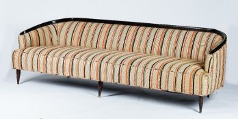 A sleek sofa, circa 1950, with curved dark stained frame,