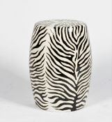 A contemporary ceramic barrel shape garden seat, imitating zebra skin, 31cm wide x 48cm high.
