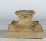 A pre-cast plinth in classical style, 27cm wide x 20cm high.