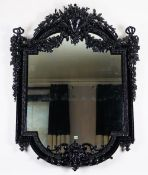 An ornate high black gloss frame mirror, in 19th century French style,