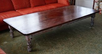 A custom made 'Vermont' cocktail table, the rectangular stained pine top,