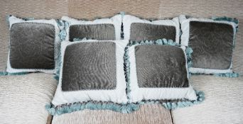A group of six cushions with tassel borders (6).