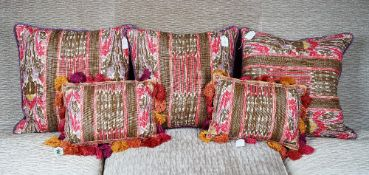 A set of three scatter cushions and another pair with tasseled borders (5).