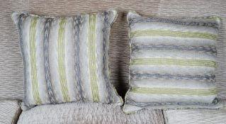 A pair of striped cushions.