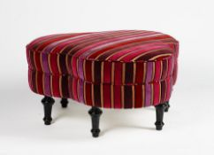 A clover-leaf shape stool, upholstered in striped velvet, on turned ebonised legs,