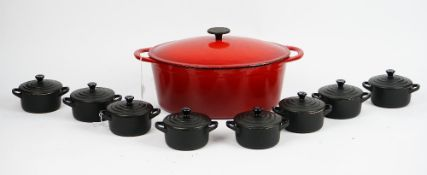 A Molten red casserole dish and eight individual Le Creuset black petit casserole dishes(9).