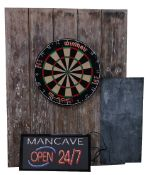 A 'Mancave' sign, illuminated 'Open 24/7' and a dartboard (2).