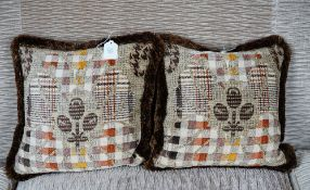 A pair of cushions in abstract check pattern material (2).