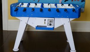 An Italian table football game, coin operated, in blue and white, 145cm wide x 89cm high.