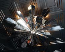 A contemporary chromium starburst light fitting, 120cm diameter.