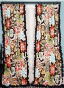 A pair of curtains, with large multicoloured wild flower pattern, with ruched black chintz trim.