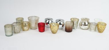 A large collection of West Elm mercurial glass tea light holders and various others in coloured