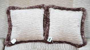 A pair of scrunched velvet and pleated silk cushions (2).