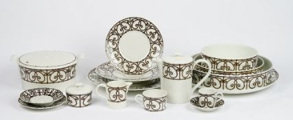 A Limoges J L Coquet tea and dinner service, essentially for eight persons,