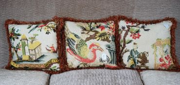 A set of three cushions, with multicoloured bird and Chinese pattern, in 18th century style,