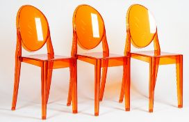 A set of eight Kartell orange lucite 'Ghost' chairs, S + ARCK by Victoria Kartell,