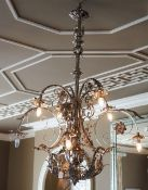 A silvered wrought metal six-light chandelier,