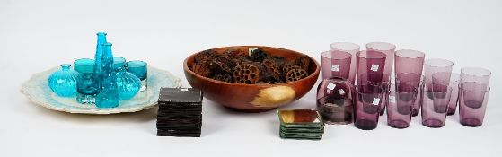 A contemporary wooden fruit bowl, amethyst glass tumblers,