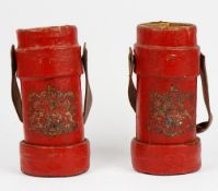 Two red painted canvas cartridge cases with leather swing handles and Royal crests, 33.