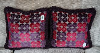 A pair of cushions in amethyst and magenta cut velvet (2).
