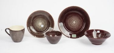 A Portuguese stoneware Meteus breakfast and dinner service with plum glaze (qty).