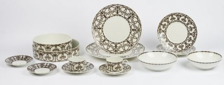 A Limoges J L Coquet tea and dinner service, and with various serving dishes (qty).