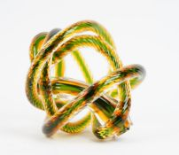 A contemporary glass sculpture of interlaced rope-twist form in clear, green and amber tint.