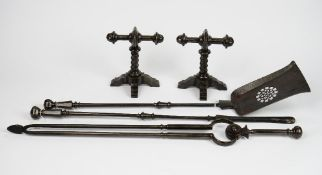 A cast iron fireplace companion set, comprising of shovel, poker, tongs and fire dogs,