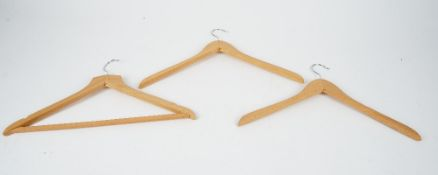 A large collection of wooden coat hangers (qty).