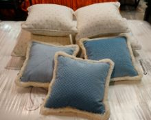 A group of cushions including four in white ribbed material (qty).