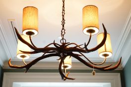 A five light chandelier composed of antlers, approximately 105cm diameter.