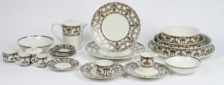 A Limoges J L Coquet tea, coffee and dinner service, essentially for eight persons,