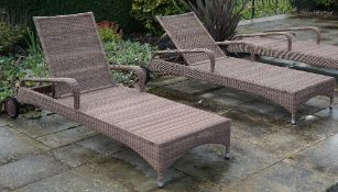 Expormim; a pair of pool side reclining loungers with loose green cushions.