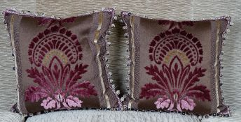 A pair of purple and old gold cut velvet cushions (2).