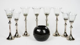 A set of eight John Lewis tea light holders, a contemporary black glass vase,