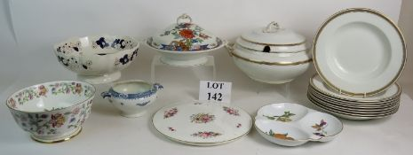 A collection of serving ware including M