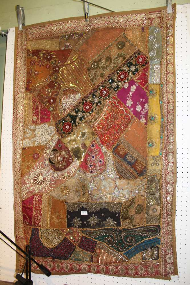Lot 89 - A HIGHLY DECORATIVE INDIAN BEAD SHELL & SEQUIN EMBROIDERED PATCHWORK THROW