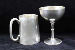A SILVER CHRISTENING MUG of plain tapering form, London 1933, inscribed, together with a silver